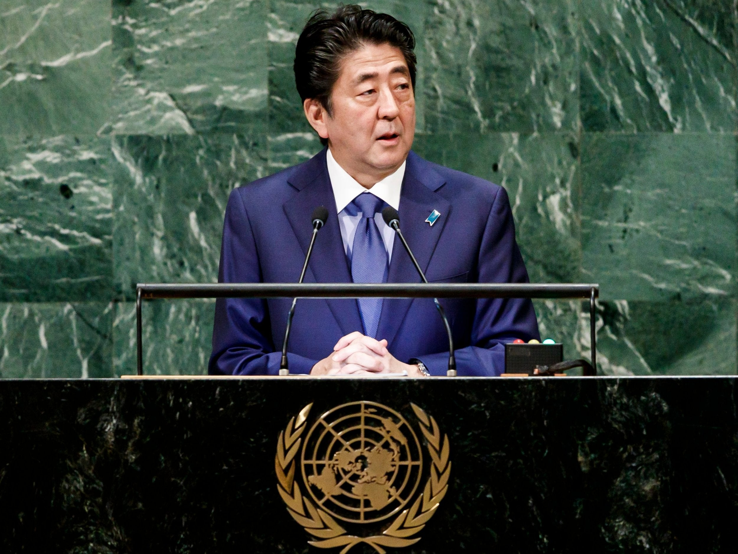 Japan's Shinzo Abe says he could meet Kim Jong-un face-to-face and 'break the shell of distrust' with North Korea