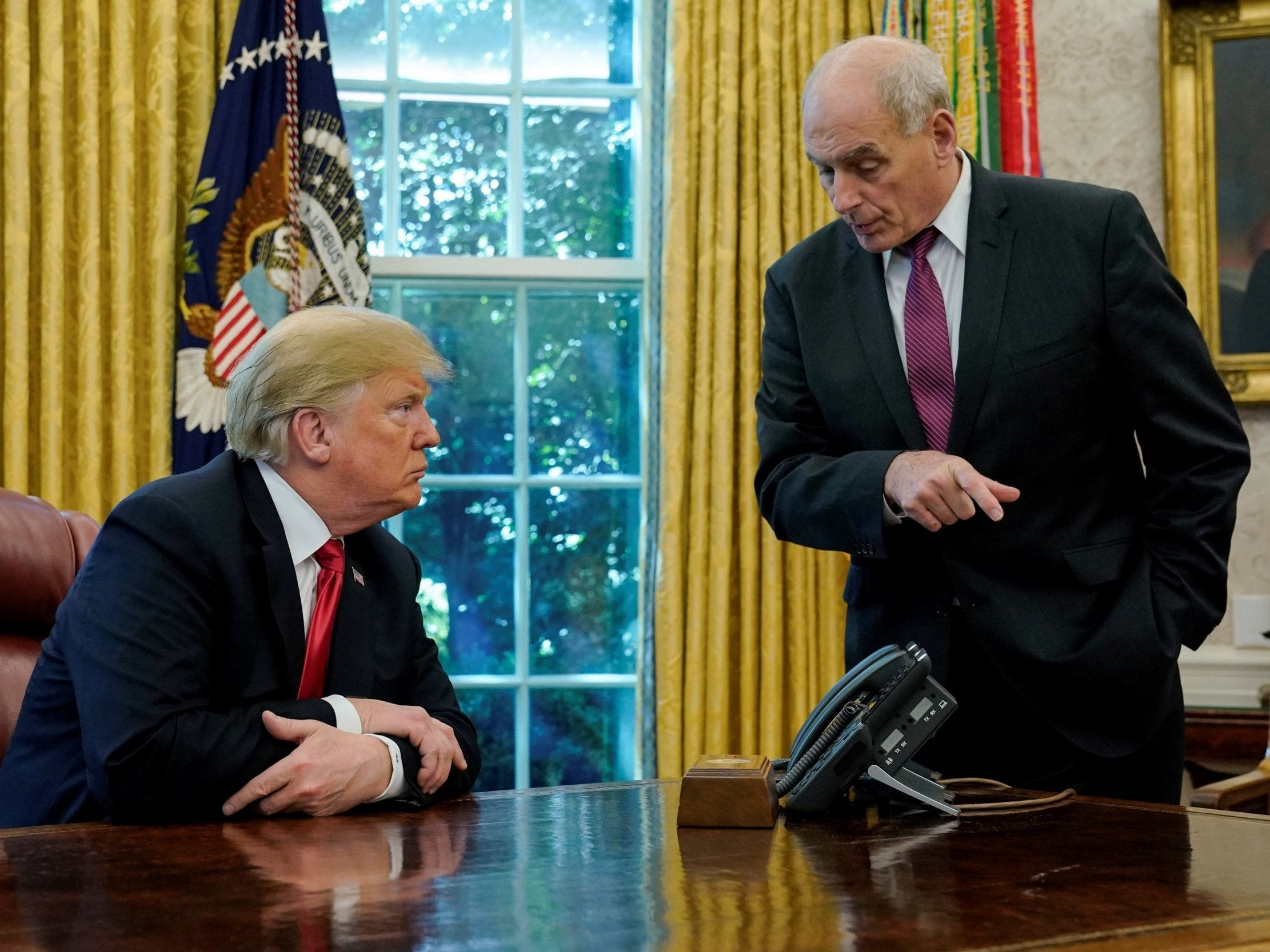 Trump tries to fire John Kelly 'but Kelly just ignores him', White House official says