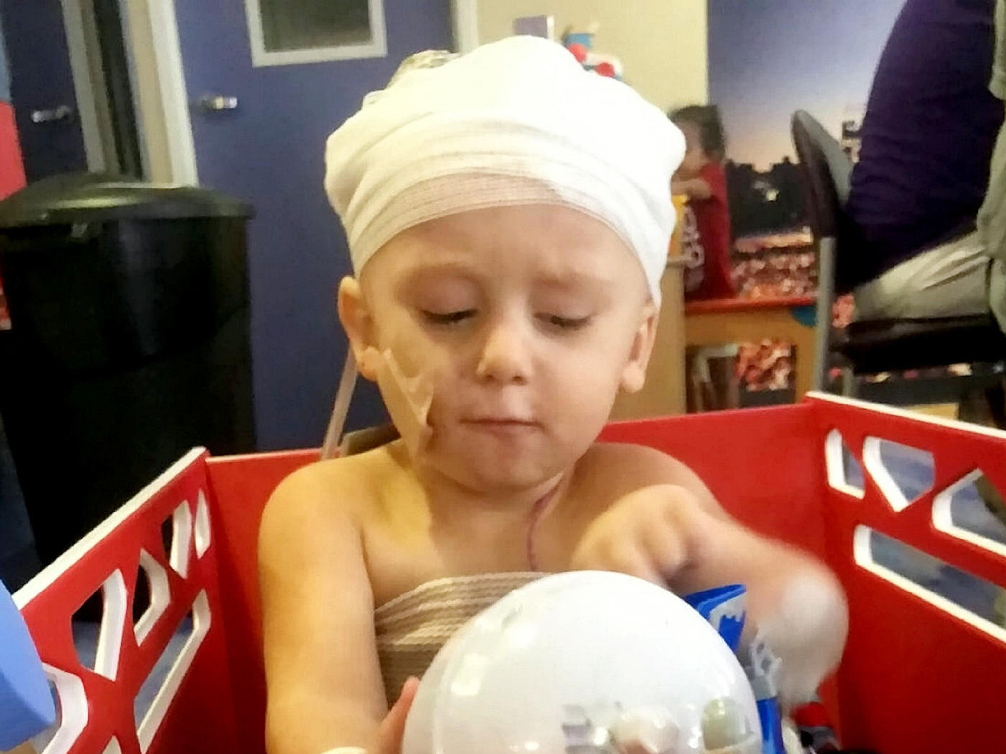 Two-year-old partially scalped after family friend reverses over him in driveway