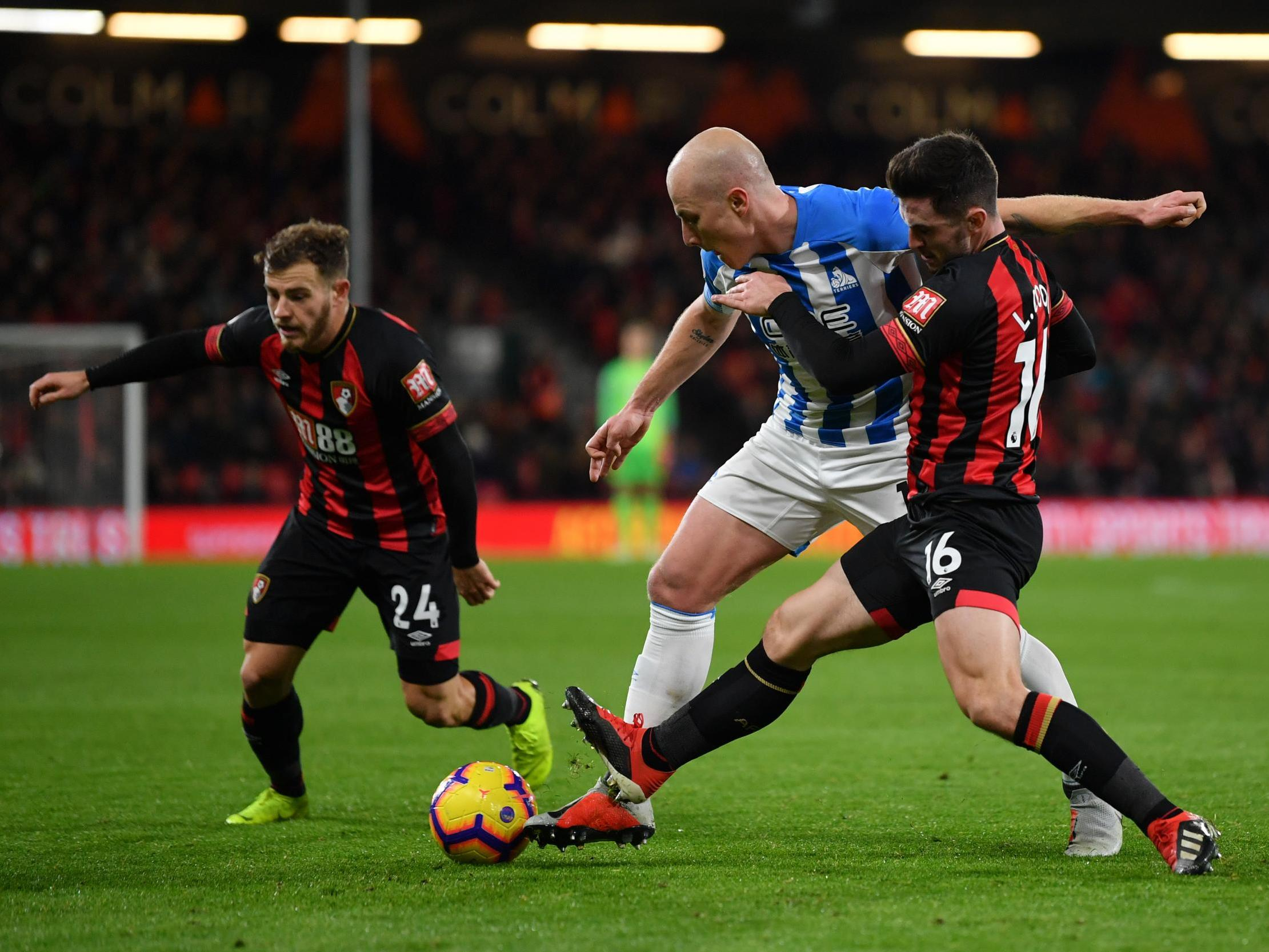 Bournemouth midfielder Lewis Cook out for six to nine months after rupturing ACL against Huddersfield Town
