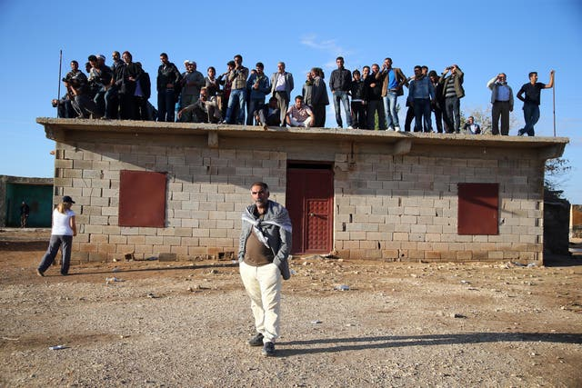 Residents of the border village of Alizar keep guard day and night as they wait in fear of mortar fire from Isis who have occupied the nearby city of Kobani