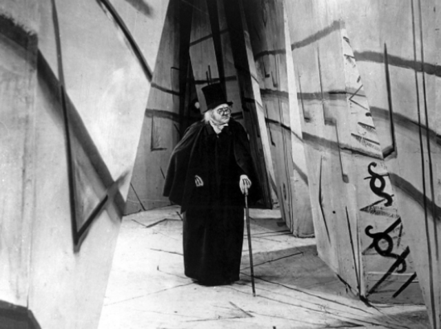Directed by: Robert Wiene . Black-and-white silent horror film The Cabinet of Dr Caligari (1920) is considered the quintessential work of German Expressionism, but also one of the scariest films in cinema history. It follows a hypnotist (Werner Krauss) who uses a somnambulist to commit murders, and Wiene's shadowed sets and striking visual style combines to unsettle the viewer in ways most filmmakers only dream of managing.
