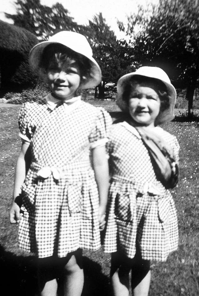 A four-year-old Camilla Parker Bowles, later the Duchess of Cornwall, is pictured with her two-year-old sister Annabel. (1952)
