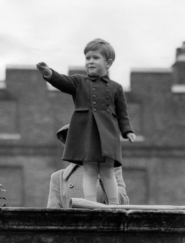 Prince Charles waves after his parents Queen Elizabeth II and the Duke of Edinburgh as they drive a procession of welcome following their return from Canada (1951)