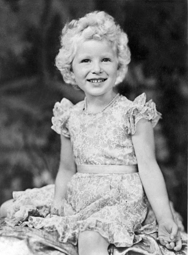 An official portrait is taken of Princess Anne, a day before her fourth birthday. (1954)