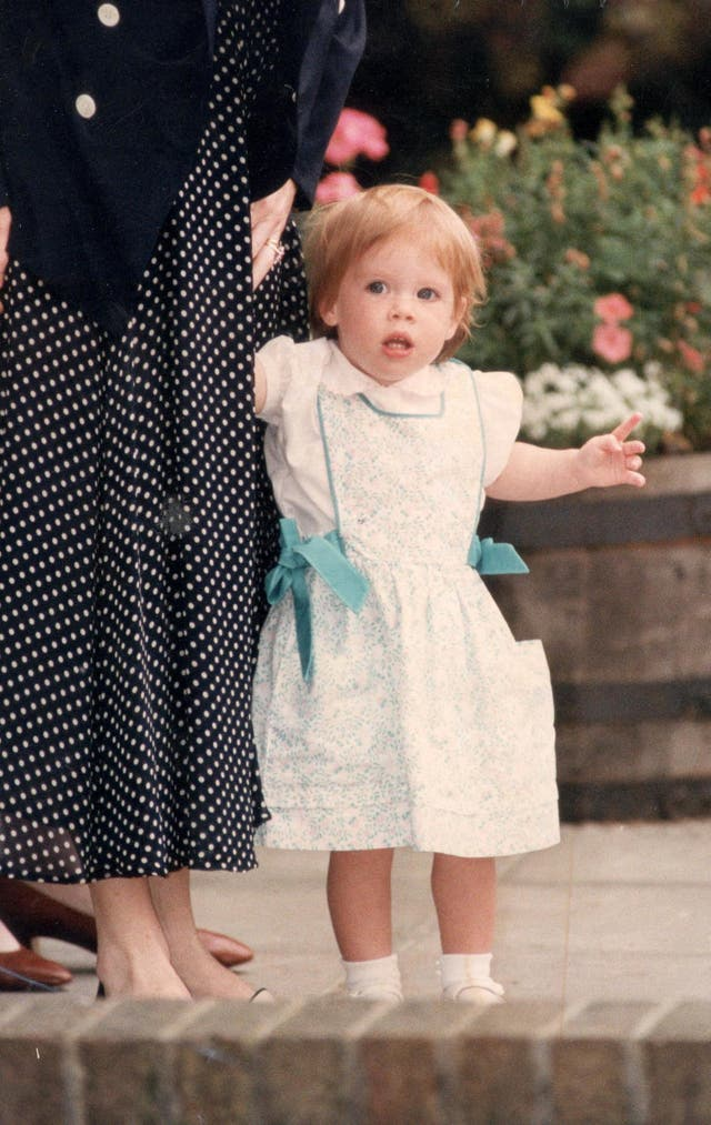 A young Princess Eugenie holds her mother, the Duchess of York's hand as she leaves Upton House School Windsor on her elder sister's first day of school. (1991)