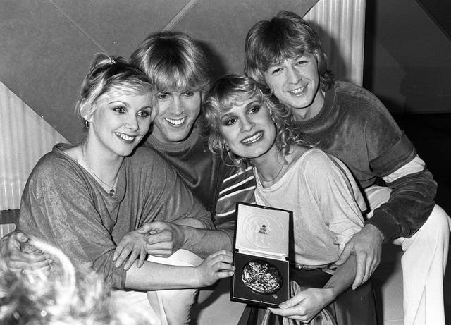 """This tune is so synonymous with British Eurovision glory, what could possibly explain it ranking no higher than 9th?  Bucks Fizz are ingrained into the national psyche by the yearly repetition of that one skirt-whipping clip. But we'd imagine that Cheryl, Jay, Mike and Bobby would be the first to say their vocals weren't quite as polished as we've come to expect from the legendary band.  However, that takes absolutely nothing away from this absolute classic. And if our rundown is inspiring you to do a bit of a Eurovision deep dive, then check out the poptastic """"Christmas With The Fizz"""" (who cares that it's May?) and Jay Aston's """"True Love"""" on Spotify."""
