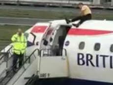 Extinction Rebellion protests: Arrests soar to 1,000 as blind paralympian clambers on top of British Airways plane