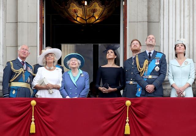 Prince Charles, Prince of Wales, Camilla, Duchess of Cornwall, Queen Elizabeth II, Meghan, Duchess of Sussex, Prince Harry, Duke of Sussex, Prince William, Duke of Cambridge and Catherine, Duchess of Cambridge watch the RAF flypast on the balcony of Buckingham Palace, as members of the Royal Family attend events to mark the centenary of the RAF