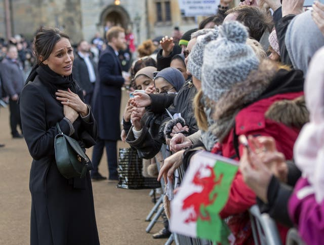 Meghan Markle greets well-wishers on arrival at Cardiff Castle for a day showcasing the rich culture and heritage of Wales
