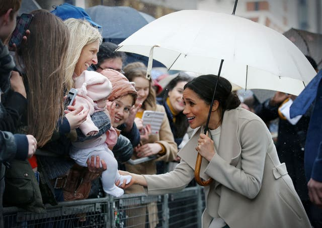 Meghan Markle greets well-wishers after a visit to one of Belfast's most historic buildings, The Crown Liquor Saloon, a former Victorian gin palace, now run by the National Trust. It was the Royal couple's first joint visit to Northern Ireland