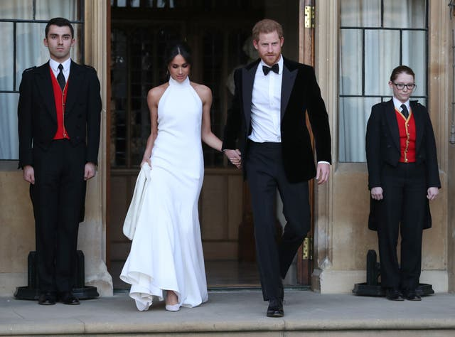 The newly married royals leave Windsor Castle after their wedding to attend an evening reception at Frogmore House