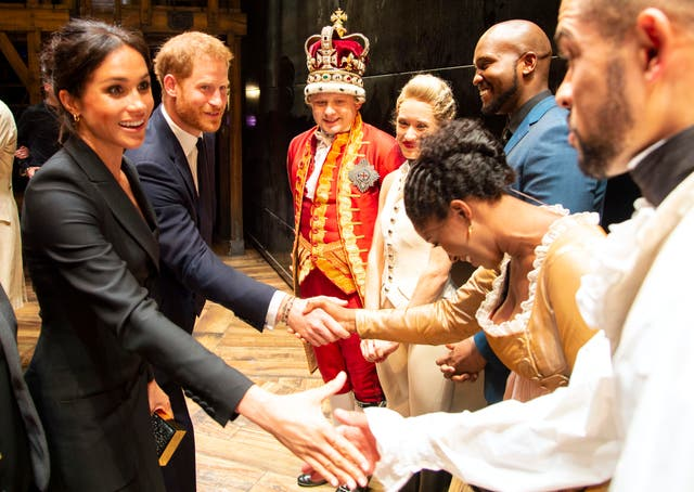 """The Duke and Duchess of Sussex meet the cast and crew of """"Hamilton"""" backstage after the gala performance in support of Sentebale at Victoria Palace Theatre"""