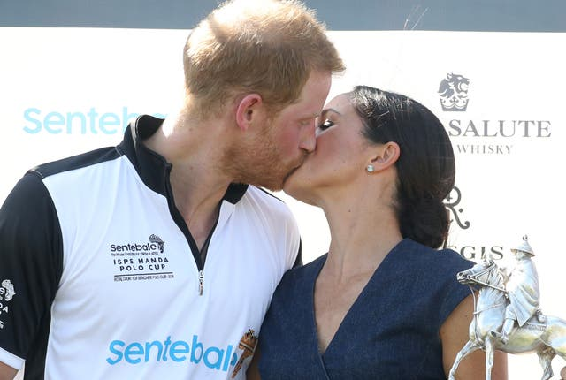 Meghan and Prince Harry kiss after the Sentebale Polo event that was held at the Royal County of Berkshire Polo Club