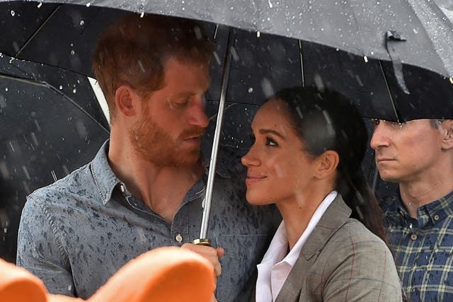 Harry and his wife Meghan watch aboriginal dances at Victoria Park in Dubbo