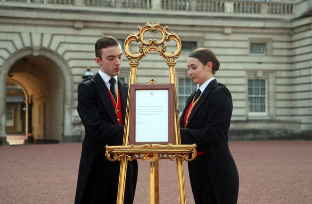 Footmen Stephen Kelly and Sarah Thompson set up an official notice on an easel at the gates of Buckingham Palace on May 6, announcing the birth of a son to Prince Harry, Duke of Sussex and Meghan, Duchess of Sussex