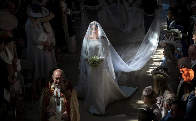 Meghan Markle walks down the aisle in St George's Chapel, Windsor Castle, during her wedding