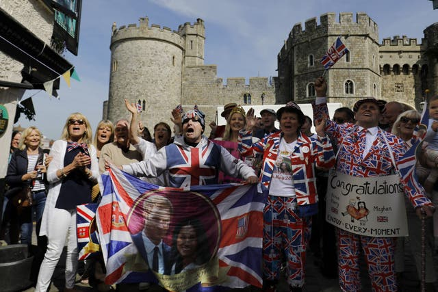 Royal fans sing for the television in Windsor the day before the Royal wedding