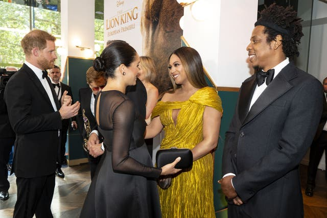 Prince Harry and Meghan meet cast and crew, including US singer-songwriter Beyonce and her husband, US rapper Jay-Z as they attend the European premiere of the film The Lion King in London