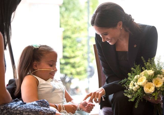 Meghan meets 7-year-old Matilda Booth during the annual WellChild awards at Royal Lancaster Hotel in London