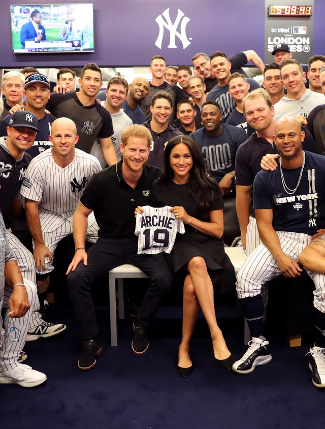 Prince Harry and Meghan join the New York Yankees in their clubhouse and receive gifts for Archie ahead of their match against the Boston Red Sox at the London Stadium. The historic two-game series marked the sport's first games ever played in Europe and The Invictus Games Foundation was selected as the official charity of Mitel and MLB London Series 2019