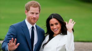 Prince Harry and Meghan Markle pose for a photograph in the Sunken Garden at Kensington Palace following the announcement of their engagement