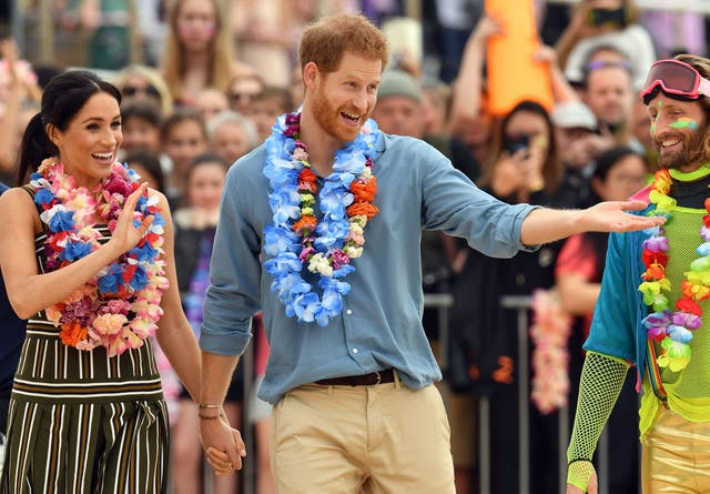 The British royals kicked off their shoes and donned tropical garlands on Bondi Beach