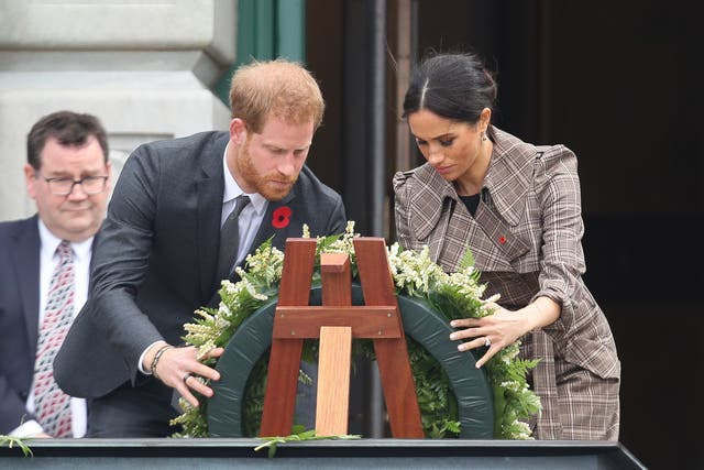 Prince Harry and Meghan laying a wreath at the National War Memorial in Wellington, New Zealand