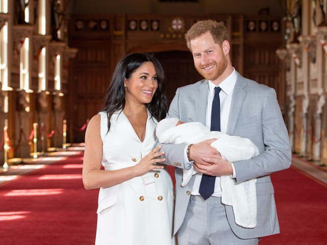 Pround parents pose with their newborn son Archie Harrison Mountbatten-Windsor in St George's Hall at Windsor Castle. The Duchess of Sussex gave birth at 5:26 on 6 May