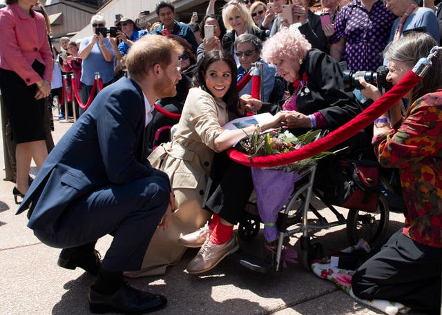 Prince Harry and Meghan meet 98-year-old Daphne Dunne during a meet and greet at the Sydney Opera House during an official 16-day Autumn tour visiting cities in Australia, Fiji, Tonga and New Zealand