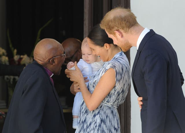 Prince Harry and Meghan hold their baby son Archie as they meet with Archbishop Desmond Tutu and his wife Leah at the Tutu Legacy Foundation in Cape Town