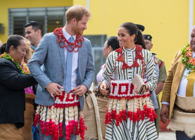 Prince Harry and Meghan visit an exhibition of Tongan handicrafts, mats and tapa cloths at the Fa'onelua Convention Centre in Nuku'alofa, Tonga