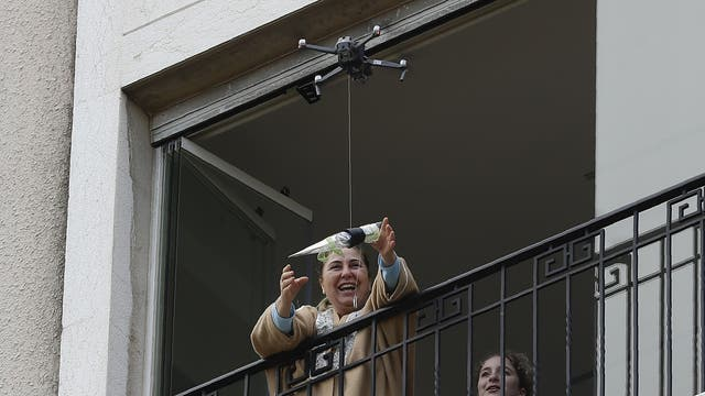 A rose is delivered by drone to a woman on Mother's Day in Jounieh, Lebanon