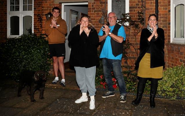 Residents in a Northampton street applaud