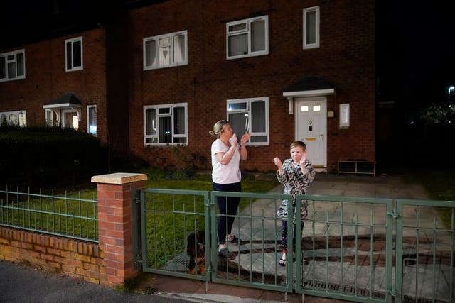 People applaud the NHS from their balconies and gardens across the road from Wythenshawe Hospital