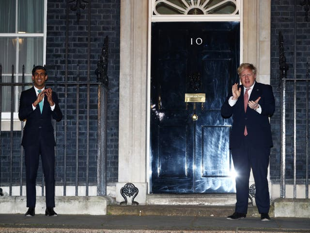 Prime Minister Boris Johnson and Chancellor of the Exchequer Rishi Sunak applaud outside 10 Downing gate