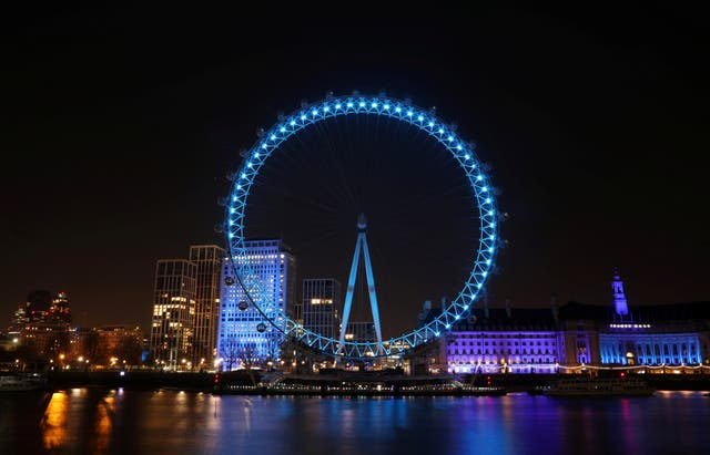The London Eye is pictured lit blue in support of the NHS
