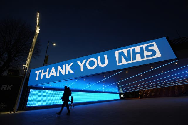 A sign by Wembley Park Tube Station in London that thanks the hardworking NHS staff