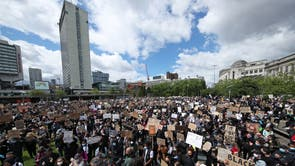People take part in a Black Lives Matter protest rally in Manchester Piccadilly Gardens