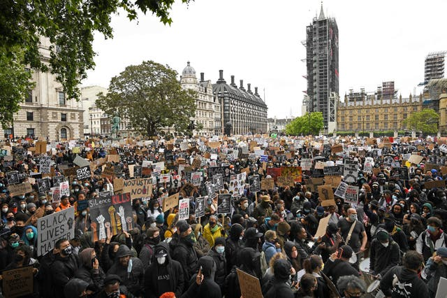 People take part in a Black Lives Matter protest rally in Parliament Square, London, in memory of George Floyd who was killed on May 25 while in police custody in the US city of Minneapolis
