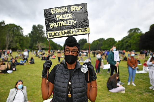People take part in a Black Lives Matter protest rally in Bute Park, Cardiff