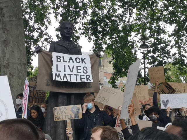 People take part in a Black Lives Matter protest rally in Parliament Square, London