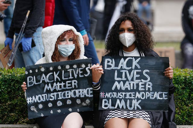 Girls hold placards in London