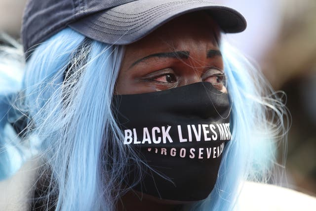 A demonstrator wearing a protective face mask during a Black Lives Matter protest in Leicester