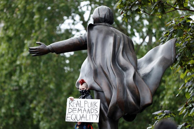 A demonstrator is seen during a Black Lives Matter protest in Parliament Square