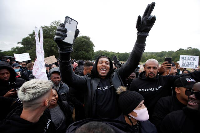 Boxer Anthony Joshua is seen with demonstrators during a Black Lives Matter protest in Watford