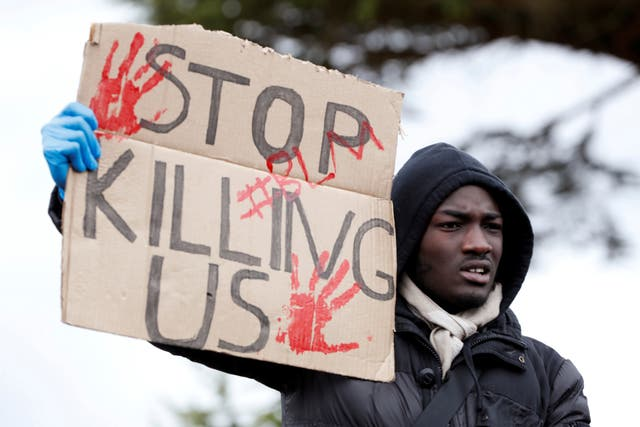 A demonstrator holds a placard during a Black Lives Matter protest in Watford