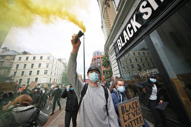People take part in a Black Lives Matter protest rally in Deansgate, Manchester