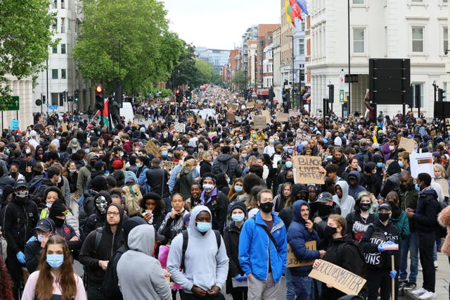 People take part in a Black Lives Matter protest rally march on Vauxhall Bridge Road, London