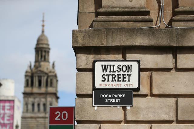 A sign alternatively naming Wilson Street 'Rosa Parks Street' in Glasgow. Activists have put up names of black people and civil rights activists throughout history alongside street names around the Scottish centre as part of the ongoing worldwide demonstrations following the death of George Floyd